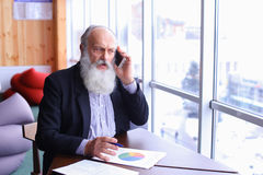 Old experienced banking account man give advice by using new sma Royalty Free Stock Photo