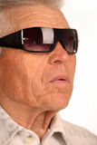 Old and experienced businessman. Elderly man with glasses, face close-up Stock Photos