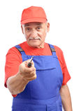 Old experienced repairman with screwdriver Royalty Free Stock Photos