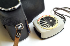 Old exposure meter and camera in leather case Royalty Free Stock Photo