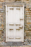 Old external door in a stone wall Stock Photography