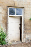 Old external door in a stone wall Royalty Free Stock Photography