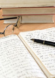 Old eyeglasses and book. Close up photo Royalty Free Stock Image