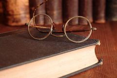 Old Eyeglasses On Bookshelf Royalty Free Stock Photo