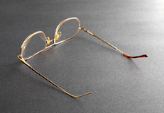 Old eyeglasses missing plastic temple tip cover Stock Photos