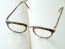 Old eyeglasses on opened book Royalty Free Stock Photos