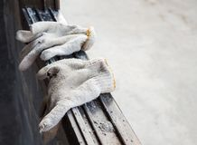 Old fabric gloves of the worker. Royalty Free Stock Photo