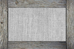 Old fabric in wooden frame Stock Images