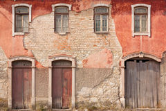 Old Facade. Abandoned facade with wood windows and doors in Portugal stock photography