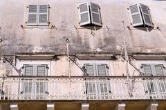 Old facade of the ancient house with windows Stock Photo