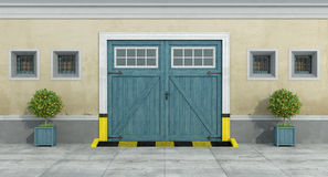 Old facade with blue car wooden garage. And little windows with grate - 3D Rendering Stock Photos
