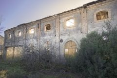Old facade of an old factory. Demolished facade of an old abandoned factory royalty free stock image