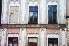 An old facade with many windows in vivid colors Royalty Free Stock Photos
