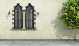 Old facade with mullioned gothic window Royalty Free Stock Image