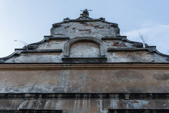 Old facade of the Roman Catholic Church on clear sky background Stock Photo