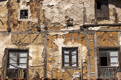 Old facade. Old ruined house adobe and wood facade Stock Photo