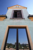 Old facade with skyreflection on the window. Picture of a fall into ruin building in Linz, Austria. Reflection of the deep blue sky in the below newer window Royalty Free Stock Photography