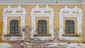 Old facade with three windows Stock Photography