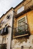 Old facade of typical Lisbon house. With hanging clothes in clothesline stock photo