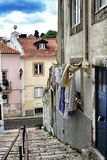 Old facade of typical Lisbon house with hanging clothes. In clothesline Stock Photography