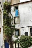 Old facade of typical Lisbon house with hanging clothes. In clothesline Royalty Free Stock Image