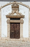 Old facade with wooden door Royalty Free Stock Photos