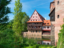 Old fachwerk house. NUREMBERG, GERMANY - JULY 26: Old fachwerk house and tower at Pegnitz river in the historical center of Nuremberg on July 26, 2015 in Stock Image