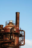Old factory. An abandoned, rusty and old gas factory royalty free stock photo