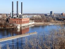 Old factory. Factory with chimneys on the Mississippi river Royalty Free Stock Images