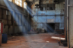 Old factory. Sun beams coming into an abandoned plant stock images