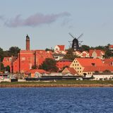 Old factory and beautiful black windmill in Ebelstoft, Djursland. Black windmill and houses in Ebeltoft, Denmark Stock Image