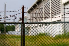 Old factory behine the metal fence. Old factory Royalty Free Stock Photos