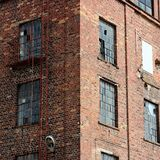 Old factory building. Old damaged factory building windows Royalty Free Stock Photography