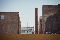 Old factory building with industrial brick chimney Stock Photo