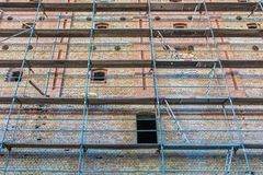 Old brick facade with scaffolding for renovation stock images