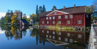 Old factory buildings of red ochre painted wood Stock Photography