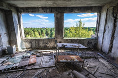 Old factory in Chernobyl Zone. Inside the former factory in Pripyat desolate city in Chernobyl Exclusion Zone, Ukraine royalty free stock image