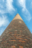 Old factory chimney. Reaching for the blue sky Royalty Free Stock Images