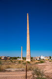Old factory chimney. Photograph of an old factory chimneys in Ceutí, Andalusia, Spain Stock Photo