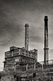 Old factory with chimneys in retro style. Old factory, abandoned place in Poland Royalty Free Stock Images