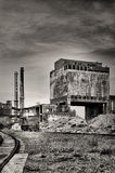 Old factory with chimneys in retro style. Old factory, abandoned place in Poland Royalty Free Stock Photo