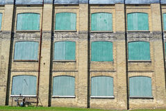 Old factory facade background Stock Photo