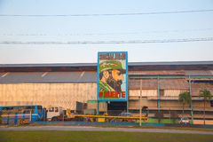 Old factory in Havana with the image of Fidel Castro Stock Images