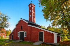 Old factory hose tower of red ochre painted wood Stock Photos