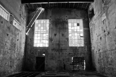 Old factory building. Black and white interior view of old factory building in rundown condition Royalty Free Stock Photo