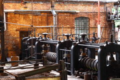 Old factory A. Photograph of heavy rollers inside an old factory royalty free stock image