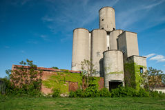 Old Factory Plant in Decay. A view of an old abandoned factory plant that has been vandalized and overgrown with weeds on the edge of Dayton, Ohio Stock Image