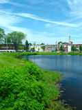 Old Factory at the pond. In the distance is an old factory on cottage street in easthampton, massachusetts, in the foreground is the nashawannuck pond and Royalty Free Stock Photography