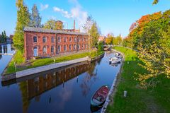 Old factory red brick buildings by the canal Stock Photo