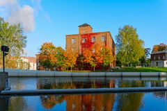 Old factory red brick buildings by the canal Royalty Free Stock Photo